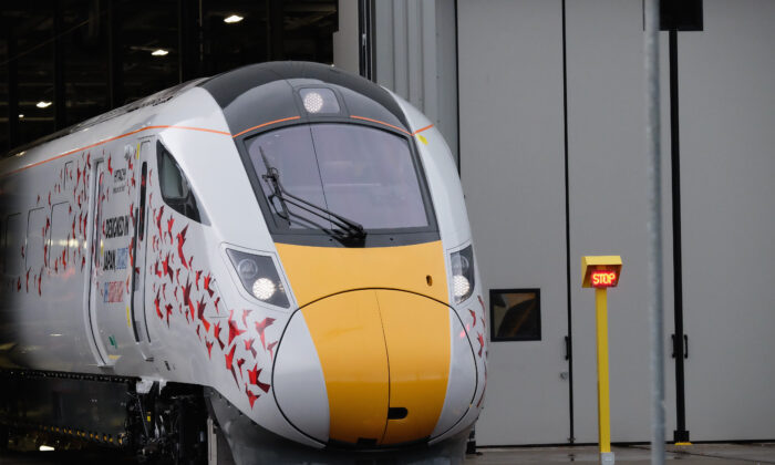 The first British-built Intercity Express train is unveiled in front of invited guests at the Hitachi Rail Europe site in Newton Aycliffe, United Kingdom, on Dec. 9, 2016. (Ian Forsyth/Getty Images)
