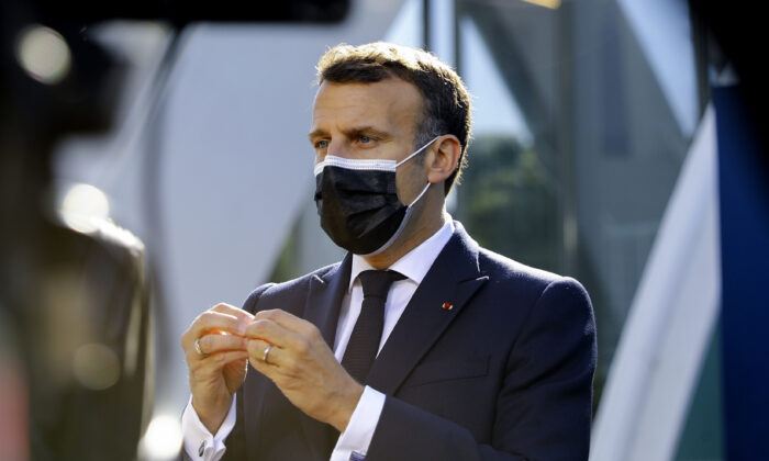 French President Emmanuel Macron speaks with the media as he arrives for an EU summit at the Crystal Palace in Porto, Portugal, on May 8, 2021. (Violeta Santos Moura /Pool via AP)