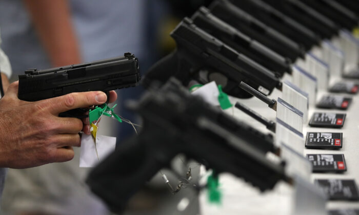 Smith and Wesson handguns are displayed during the NRA Annual Meeting & Exhibits at the Kay Bailey Hutchison Convention Center in Dallas, Texas, on May 5, 2018. (Justin Sullivan/Getty Images)