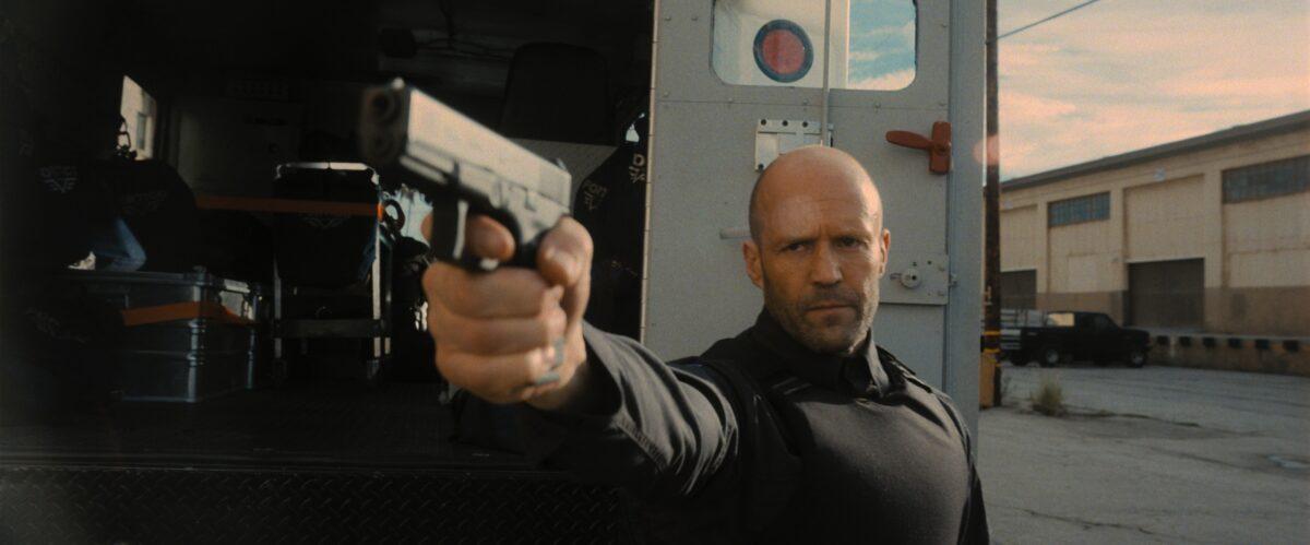 man points pistol in Wrath of Man