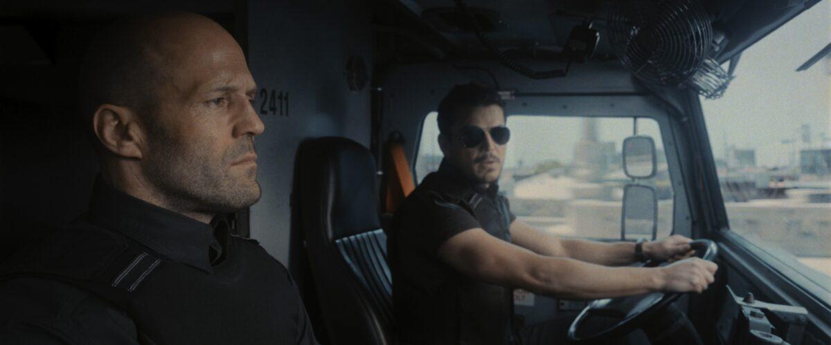 two men in truck in Wrath of Man