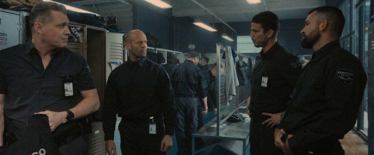 four men in locker room in Wrath of Man
