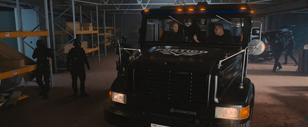 Brink's truck surrounded by bad guys in Wrath of Man