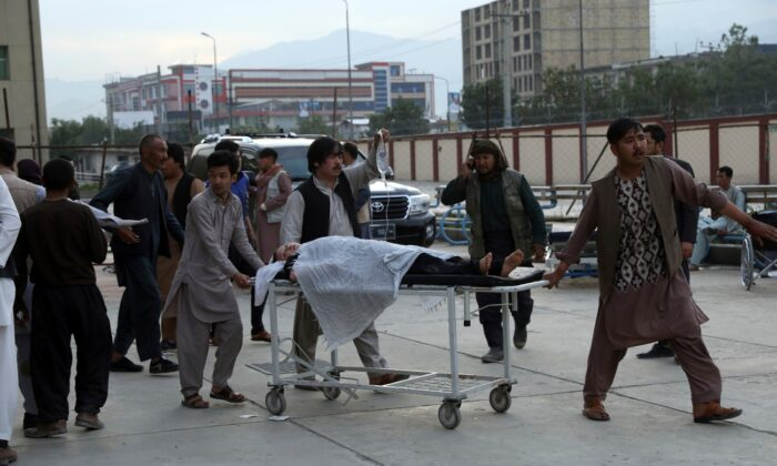 An injured school student is transported to a hospital after a bomb explosion near a school in west of Kabul, Afghanistan, on May 8, 2021. (Rahmat Gul/AP Photo)