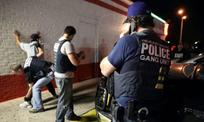 Federal agents with the U.S. Immigration and Customs Enforcement's (ICE) Homeland Security Investigations (HSI) detain a man in this file photo taken in Dallas, Texas, in March 2014. (ICE/Charles Reed/Handout/File Photo via Reuters)