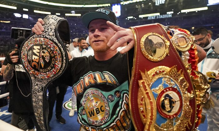 Canelo Alvarez celebrates after defeating Billy Joe Saunders in a unified super middleweight world championship boxing match, in Arlington, Texas, on May 8, 2021. (Jeffrey McWhorter/AP Photo)
