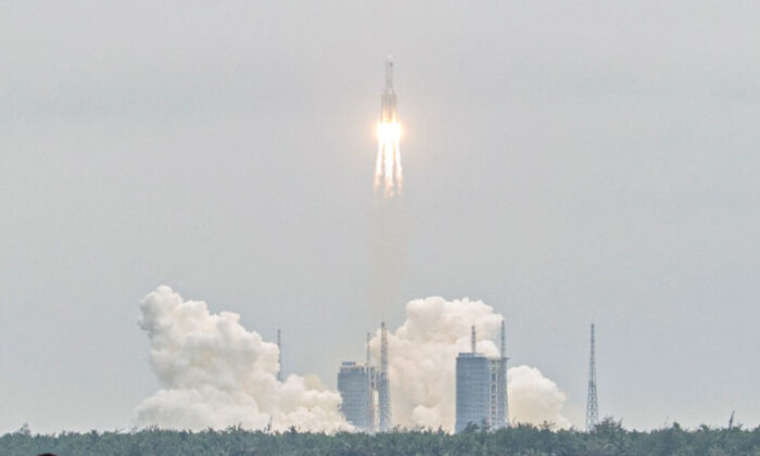 The Long March 5B rocket, which carries China's Tianhe space station core module, lifts off from the Wenchang Space Launch Center, in southern China's Hainan province on April 29, 2021. (STR/AFP via Getty Images)