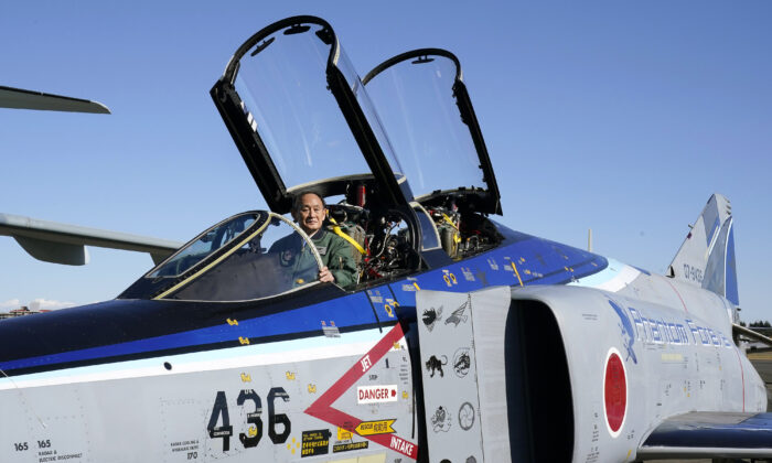 Japanese Prime Prime Minister Yoshihide Suga sits in the cockpit of a F4EJ Kai jet fighter of Japan's Air Self-Defense Force after reviewing the force's personnel at Iruma Air Base in Sayama, Saitama Prefecture, on Nov. 28, 2020. (Kimimasa Mayama/Pool/AFP via Getty Images)