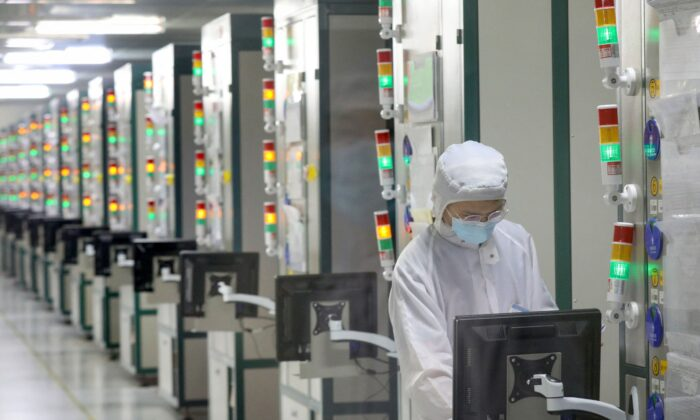 An employee works at a factory of Jiejie Semiconductor Company in Nantong, China, on March 17, 2021.  (STR/AFP via Getty Images)
