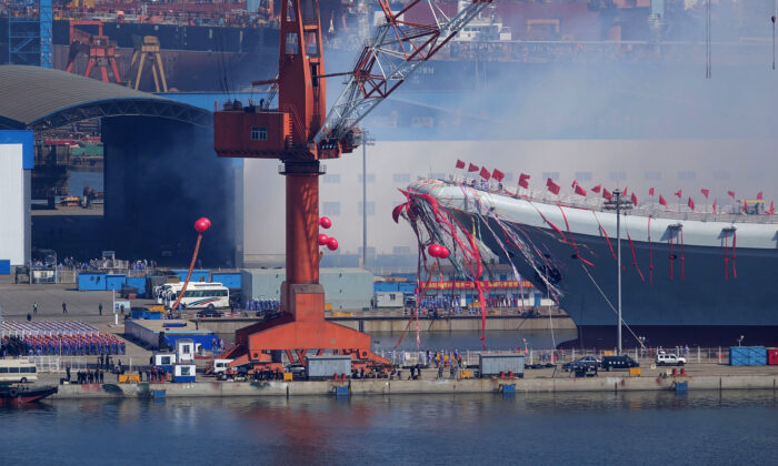 Type 001A, China's second aircraft carrier, is transferred from the dry dock into the water during a launch ceremony at Dalian shipyard in Dalian, northeast China's Liaoning Province, on April 26, 2017. China has launched its first domestically designed and built aircraft carrier, state media said on April 26, as the country seeks to transform its navy into a force capable of projecting power onto the high seas. (STR/AFP via Getty Images)