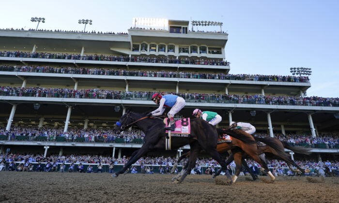 John Velazquez riding Medina Spirit leads Florent Geroux on Mandaloun and Flavien Prat riding Hot Rod Charlie to win the 147th running of the Kentucky Derby at Churchill Downs in Louisville, Ky., on May 1, 2021. (Jeff Roberson/AP Photo)