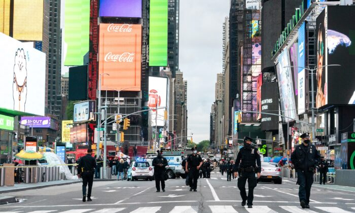 New York City police officers stand guard after a shooting incident in Times Square, New York City, on May 8, 2021. (Jeenah Moon/Reuters)