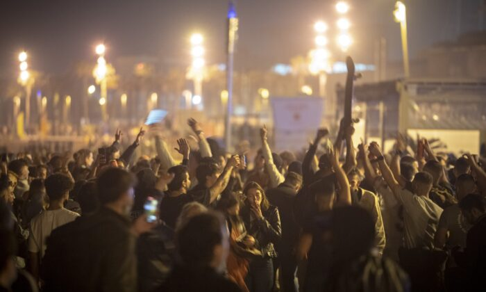 People crowded and dance on the beach in Barcelona, Spain, on May 9, 2021. (Emilio Morenatti/AP Photo)
