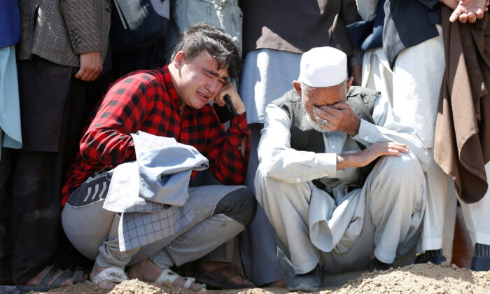 Relatives mourn the victims of May 8's explosion during a mass funeral ceremony in Kabul, Afghanistan, on May 9, 2021. (Stringer/Reuters)