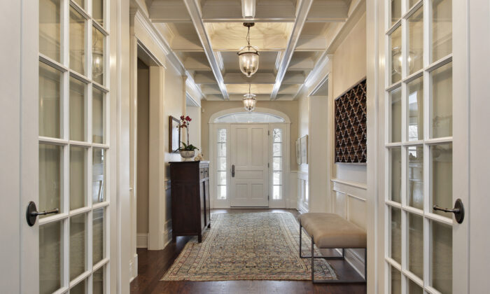 Don't scrimp on some of the open areas such as the foyer or entrance to a stairway, even though these two areas are not particularly usable floor space.  (pics721/Shutterstock)