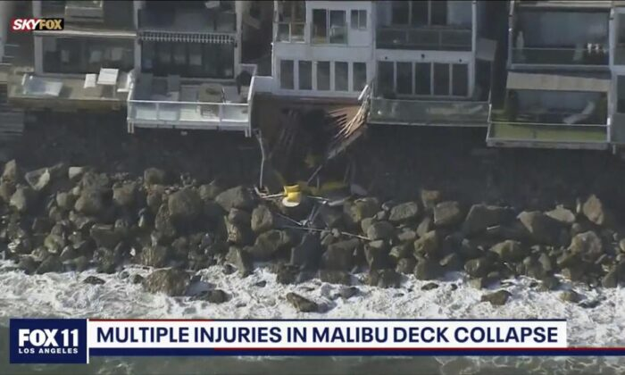 An aerial screenshot of Los Angeles County firemen at the scene of a collapsed balcony incident in Malibu, Calif., on May 8, 2021. (Fox 11 KTTV via AP)