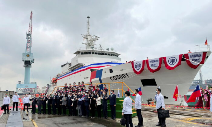 Taiwan President Tsai Ing-wen and others pose for photos in front of the newly launched coast guard flagship Chiayi in Kaohsiung, Taiwan, on April 29, 2021. (Yimou Lee/Reuters)
