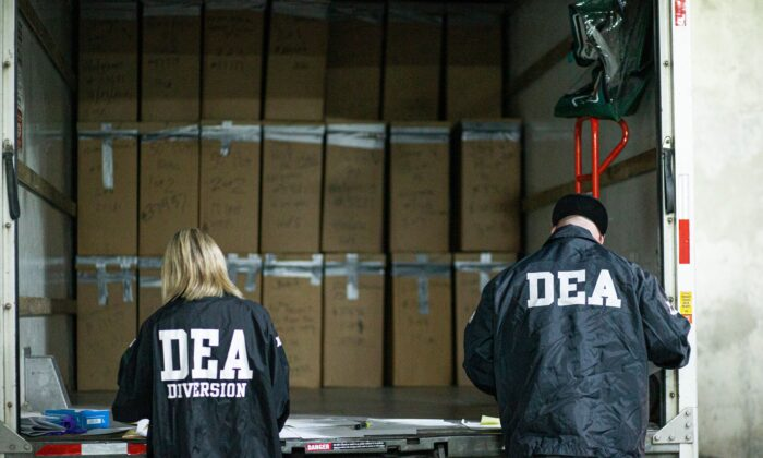 Prescriptions drugs collected during the Drug Enforcement Administration (DEA)s Take Back Day event are placed into plastic bags by members of the DEA in White Plains, New York on April 24, 2021. (Kena Betancur/AFP via Getty Images)