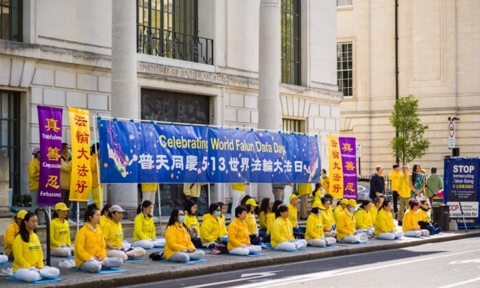 Falun Gong practitioners celebrate World Falun Dafa Day in central London on May 10, 2021. (Yanning Qi/The Epoch Times)