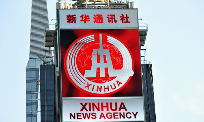 An electronic billboard leased by Xinhua, the news agency operated by the Chinese regime, makes its debut in New York's Times Square on Aug. 1, 2011. (Stan Honda/AFP via Getty Images)