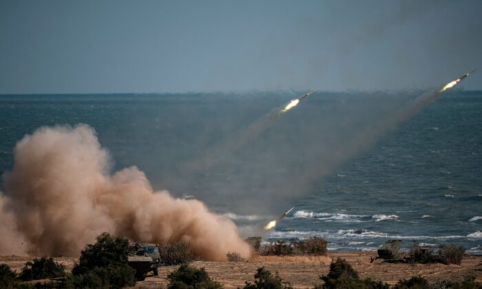 """Rockets launch from missile systems at the Turali range on the Caspian Sea coast in the Republic of Dagestan in Southern Russia during the """"Caucasus-2020"""" military drills gathering China, Iran, Pakistan and Myanmar troops, along with ex-Soviet Armenia, Azerbaijan and Belarus, on Sept. 23, 2020. (Dimitar Dilkoff/AFP via Getty Images)"""
