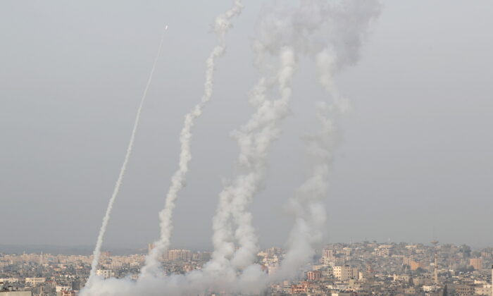 Rockets are launched by Palestinian militants into in Gaza, Israel, on May 10, 2021. (Mohammed Salem/Reuters)