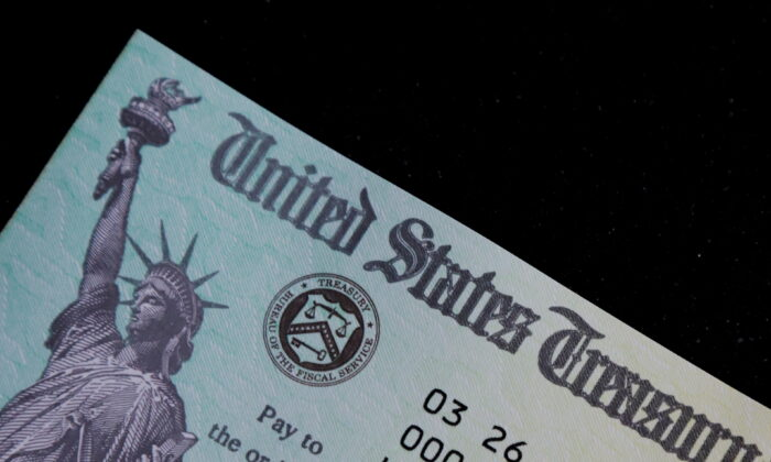 A family's stimulus check from the U.S. Treasury for COVID-19 aid arrived in the mail in Milton, Massachusetts, on March 25, 2021. (Brian Snyder/Reuters)