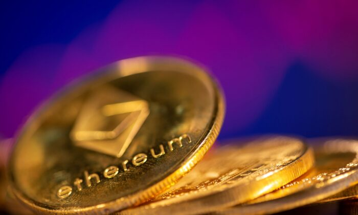 A representation of virtual currency Ethereum are seen in front of a stock graph in this illustration, on Feb. 19, 2021. (Dado Ruvic/Reuters)
