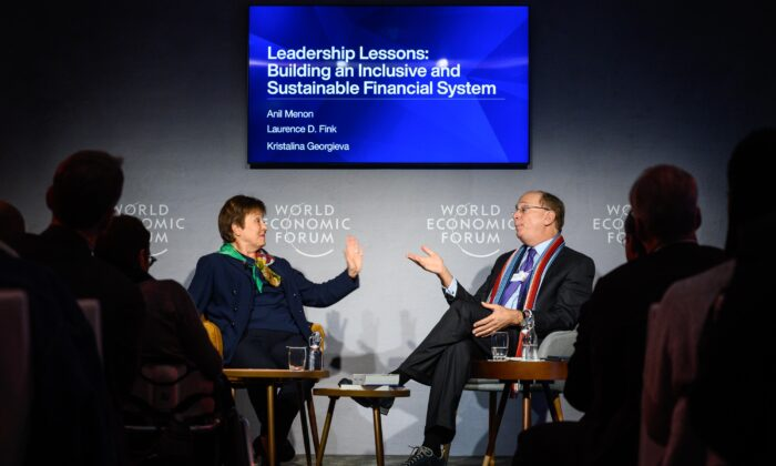International Monetary Fund (IMF) Managing Director Kristalina Georgieva (L) talks with BlackRock Chair and CEO Laurence D. Fink during a session at the World Economic Forum (WEF) annual meeting in Davos, on Jan. 23, 2020. (Fabrice Coffrini/AFP via Getty Images)