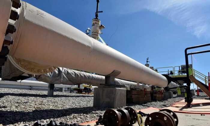In this June 8, 2017, file photo, fresh nuts, bolts and fittings are ready to be added to the east leg of the pipeline near St. Ignace, Mich., as Enbridge prepares to test the east and west sides of the Line 5 pipeline under the Straits of Mackinac in Mackinaw City, Mich. (The Canadian Press/Detroit News via AP, File/AP-Dale G Young)