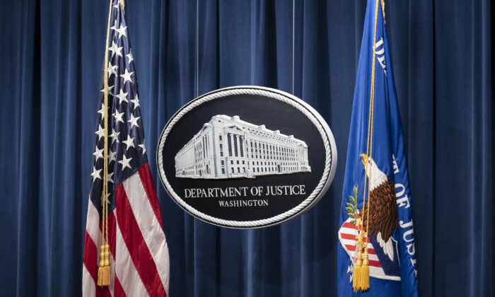 A sign for the Department of Justice is seen ahead of a news conference with Michael Sherwin, acting US attorney for the District of Columbia, and Steven D'Antuono, head of the Federal Bureau of Investigation (FBI) Washington field office, at the US Department of Justice in Washington on Jan. 12, 2021. (Sarah Silbiger/POOL/AFP via Getty Images)