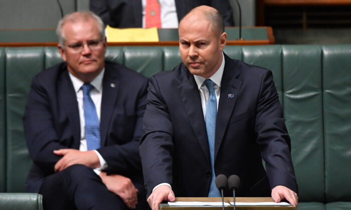 CANBERRA, AUSTRALIA - OCTOBER 06: Treasurer Josh Frydenberg during the budget delivery in the House of Representatives on October 06, 2020 in Canberra, Australia. The Morrison government's second budget was published on Tuesday, after its release in May was delayed by the COVID-19 pandemic. Treasurer Frydenberg has delivered a federal budget deficit of $213.7  billion in the wake of coronavirus and related shutdowns, with a number of tax cuts to be introduced to help boost the economy and create jobs as Australia experiences its first recession in 29 years.  (Photo by Sam Mooy/Getty Images)
