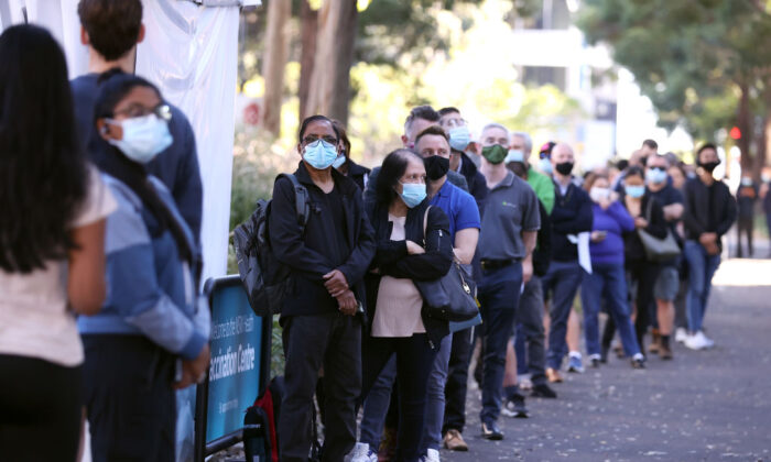 People are seen queuing to enter a mass COVID-19 vaccination hub in Sydney, Australia, on May 10, 2021. (Mark Kolbe/Getty Images)