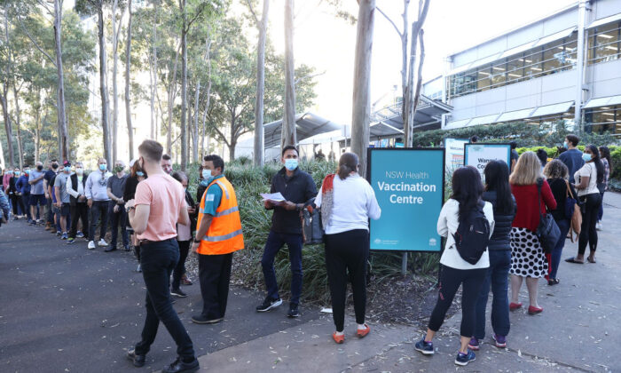 People are seen queuing to enter a mass COVID-19 vaccination hub on May 10, 2021 in Sydney, Australia. (Mark Kolbe/Getty Images)