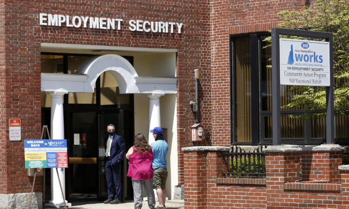 Job seekers line up outside the New Hampshire Works employment security job center  in Manchester, N.H., on May 10, 2021. (Mary Schwalm/AP Photo)