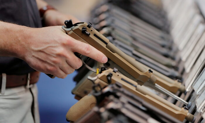 A man inspects a handgun inside of the Beretta booth during the National Rifle Association (NRA) annual meeting in Indianapolis, Indiana, U.S. on April 28, 2019.  (Lucas Jackson/Reuters File Photo)