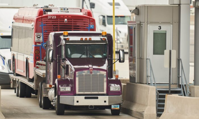 A trucker waits at the Canada Customs booth in Sarnia, Ontario, on March 16, 2020. (Geoff Robins/AFP via Getty Images)