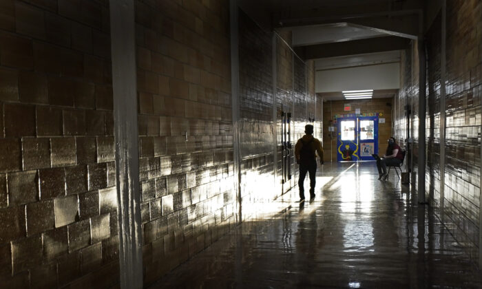 A student walks between classes at Wyandotte High School in Kansas City, Kan., on the first day of in-person learning, on March 30, 2021. (Charlie Riedel/AP Photo)
