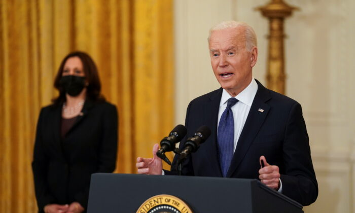President Joe Biden delivers remarks as Vice President Kamala Harris stands by in the East Room at the White House in Washington on May 10, 2021. (Kevin Lamarque/Reuters)