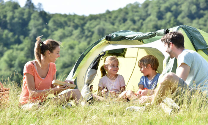 A family adventure, whether it's a camping trip or a luxury getaway, strengthens family bonds. (goodluz/Shutterstock)