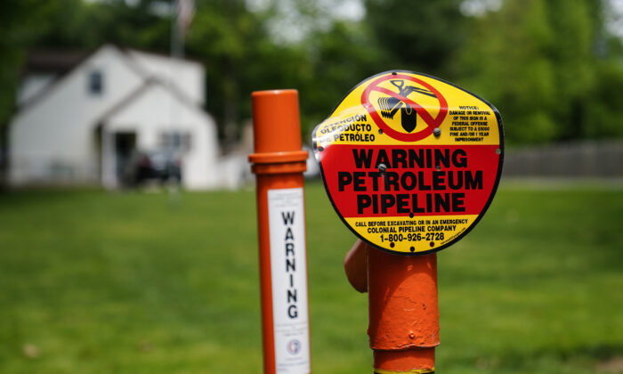 A warning sign is posted along the path of the Colonial Pipeline in Garnet Valley, PA. on Monday, May 10, 2021. (Matt Rourke/AP Photo)