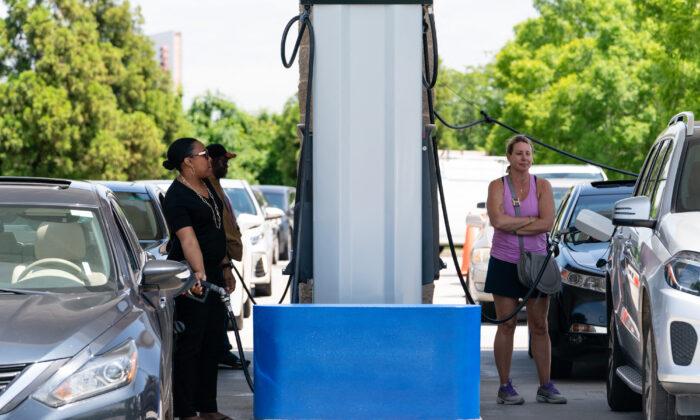 People pump gas at a Costco gasoline station in Atlanta, Ga., on May 11, 2021. (Elijah Nouvelage/AFP via Getty Images)