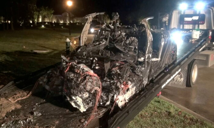 The remains of a Tesla vehicle are seen after it crashed in The Woodlands, Texas, April 17, 2021, in this still image from video obtained via social media. (Scott J. Engle via Reuters)