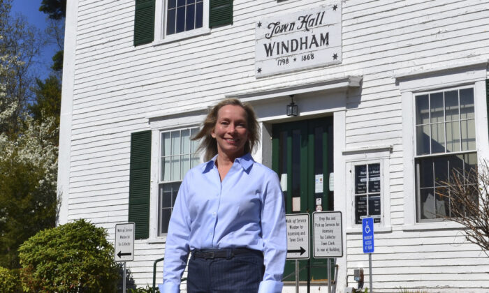 Kristi St. Laurent, who ran for a House seat in the 2020 election, poses in front of Town Hall in Windham, N.H., on May 7, 2021. (Michael Casey/AP Photo)