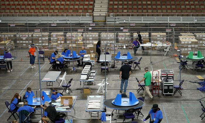 Maricopa County ballots cast in the 2020 general election are examined and recounted by contractors working for Florida-based company, Cyber Ninjas, at Veterans Memorial Coliseum in Phoenix, Ariz., on May 6, 2021. (Matt York/AP Photo)