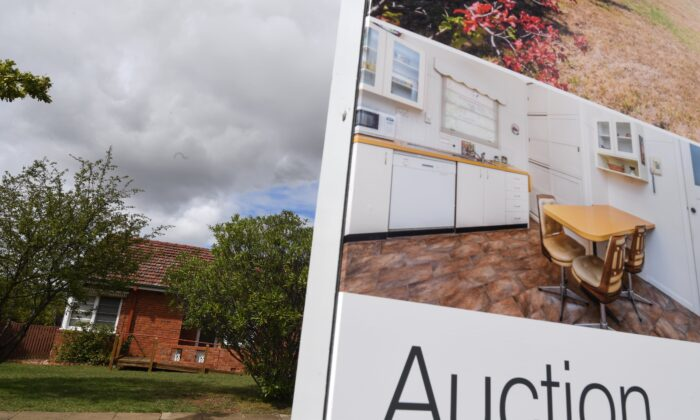 A real estate advertising board is seen in Canberra, Australia, April 4, 2017. (AAP Image/Lukas Coch)