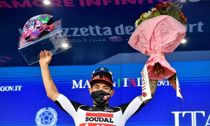 Lotto Soudal rider Caleb Ewan of Australia celebrates on the podium after winning Stage 5 of the Giro d'Italia, in Cattolica, Italy on May 12, 2021. (Jennifer Lorenzini/Reuters)