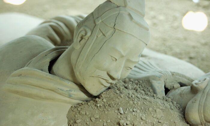 An imitation of a Qin Dynasty terracotta warrior lies in the Old Xian Museum in Xian, Shaanxi Province, China, on April 4, 2006. (China Photos/Getty Images)