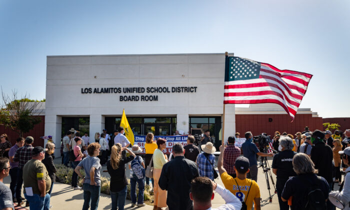 Demonstrators gather in front of Los Alamitos Unified School District Headquarters in Los Alamitos, Calif., on May 11, 2021. (John Fredricks/The Epoch Times)