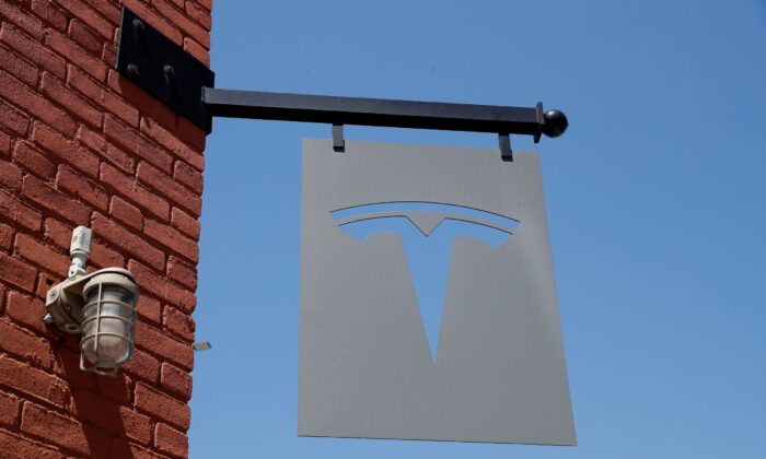 The TESLA logo is seen outside a dealership in the Brooklyn borough of New York City, on April 26, 2021. (Shannon Stapleton/Reuters)